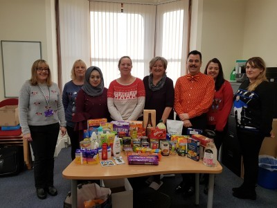 Self Help UK staff pictured with our donations to the foodbank